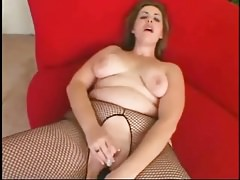 Big BBW nympho plays with..