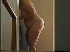 Gran naked entering shower.