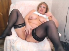 mature opens big pussy wide