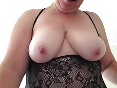 Mature chubbie plays with..